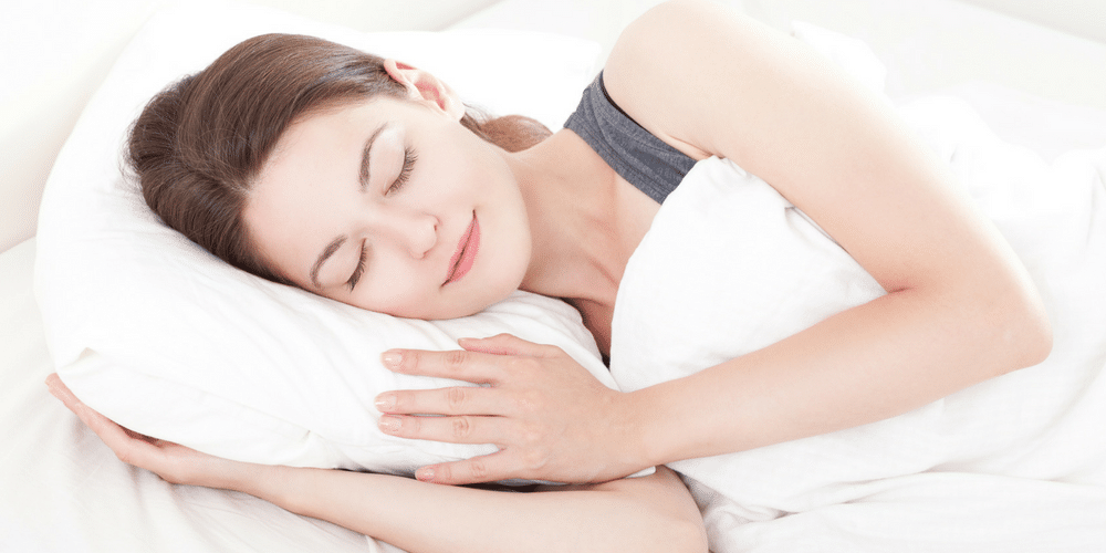 Woman sleeping very comfortably on her Sleep Natural pillow because they ar ethe best natural pillows around.