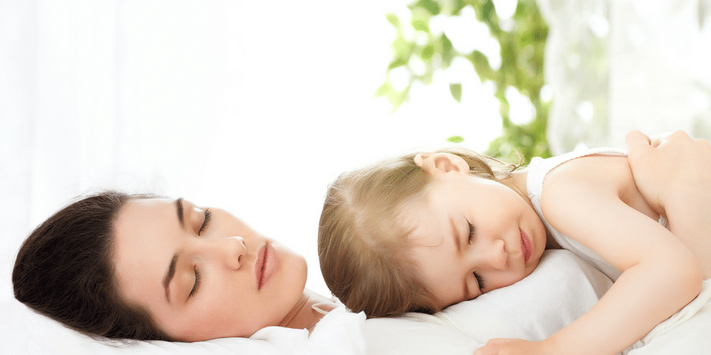 Mother and daughter sleeping soundly on an organic mattress