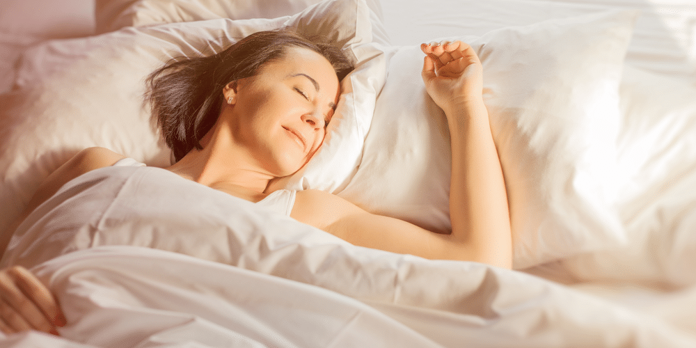 Woman sleeping comfortably on her new eco-friendly mattress