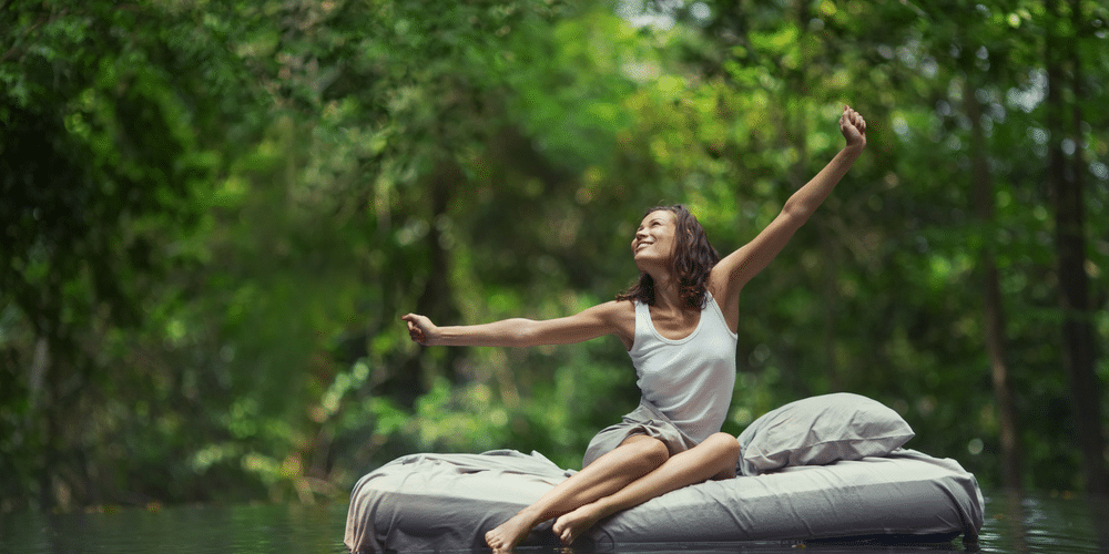 Woman waking up happy, knowing that the mattress she's sleeping on is a natural latex mattress and is chemical free