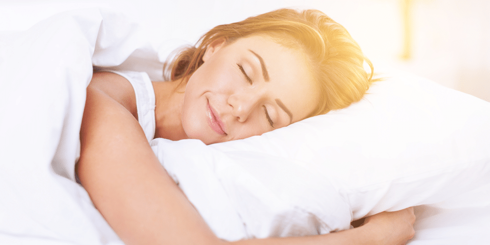 Woman sleeping on a natural memory foam mattress that's healthier for the environment