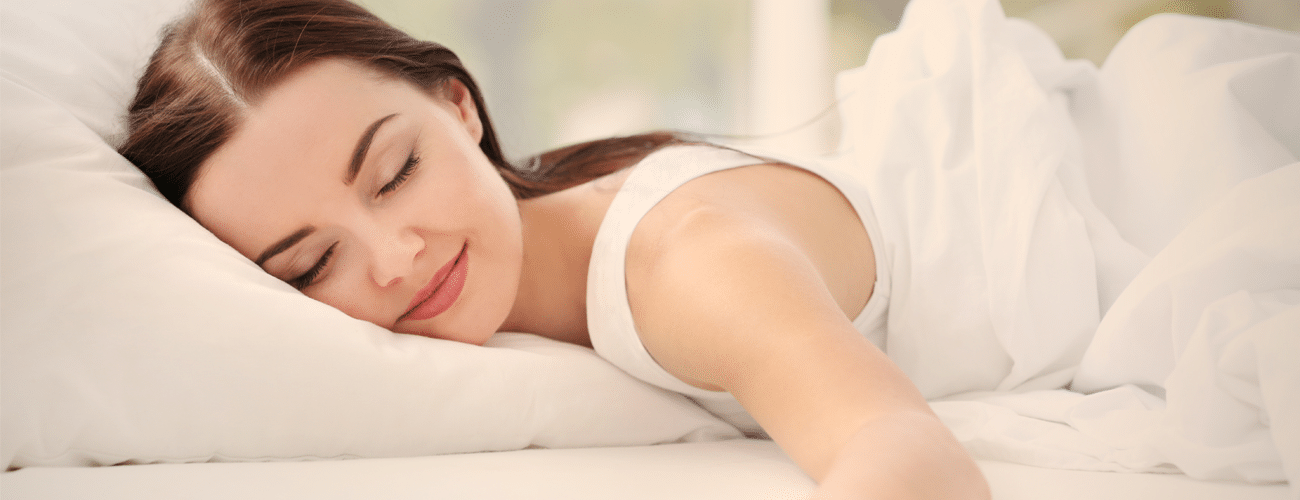 woman sleeping on a memory foam pillow