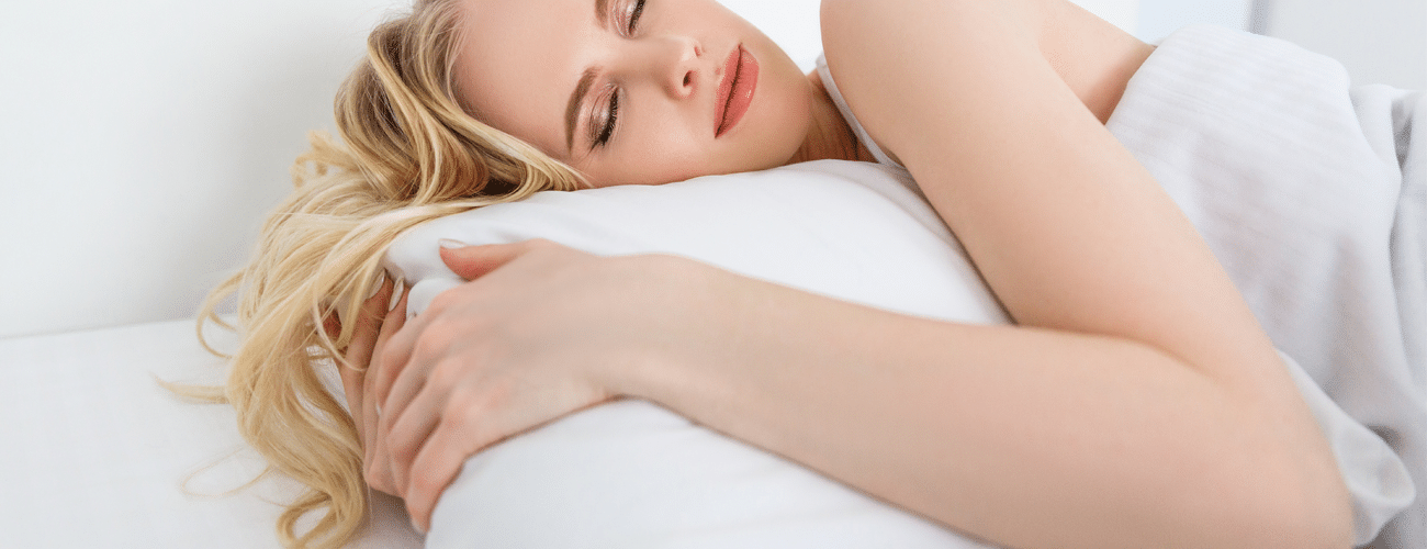 woman enjoying sleeping from the memory foam pillow benefits
