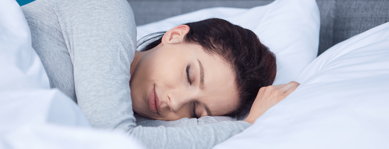 a woman sleeping pleasantly with a cooling pillow